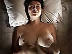 Point-of-view big tits on a bed