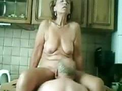 Older wife licked and fingered in kitchen
