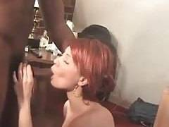 Redhead Holly takes on a big blackcock with all her holes