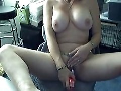 Big Boobed sexy brunette Masturbates With A Vibrator On A Chair And Moans