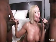 Nympho blond Milf throating and sucking two BBCs