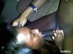 african woman blowing on a monster BBC